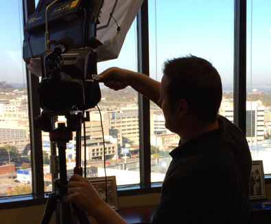 Nick setting up for a on location video production - video tips and shortcuts