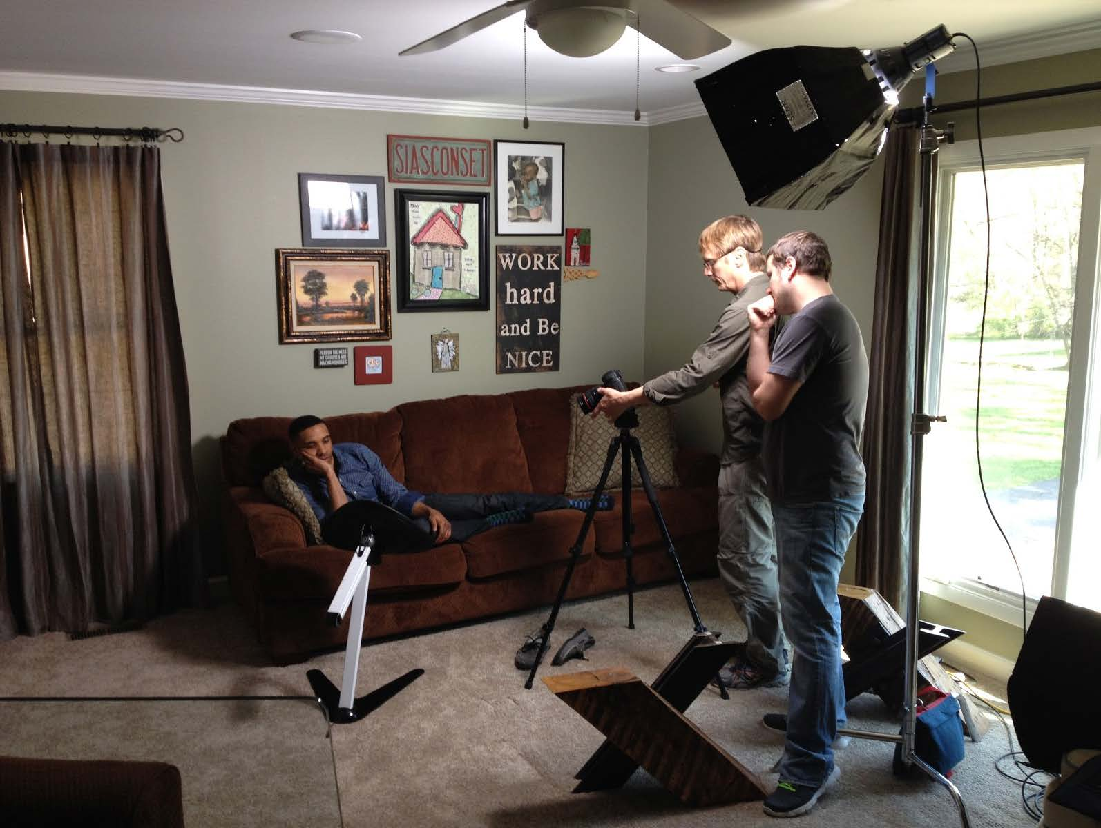 Camera man in home filming a person talking about their Kickstarter campaign