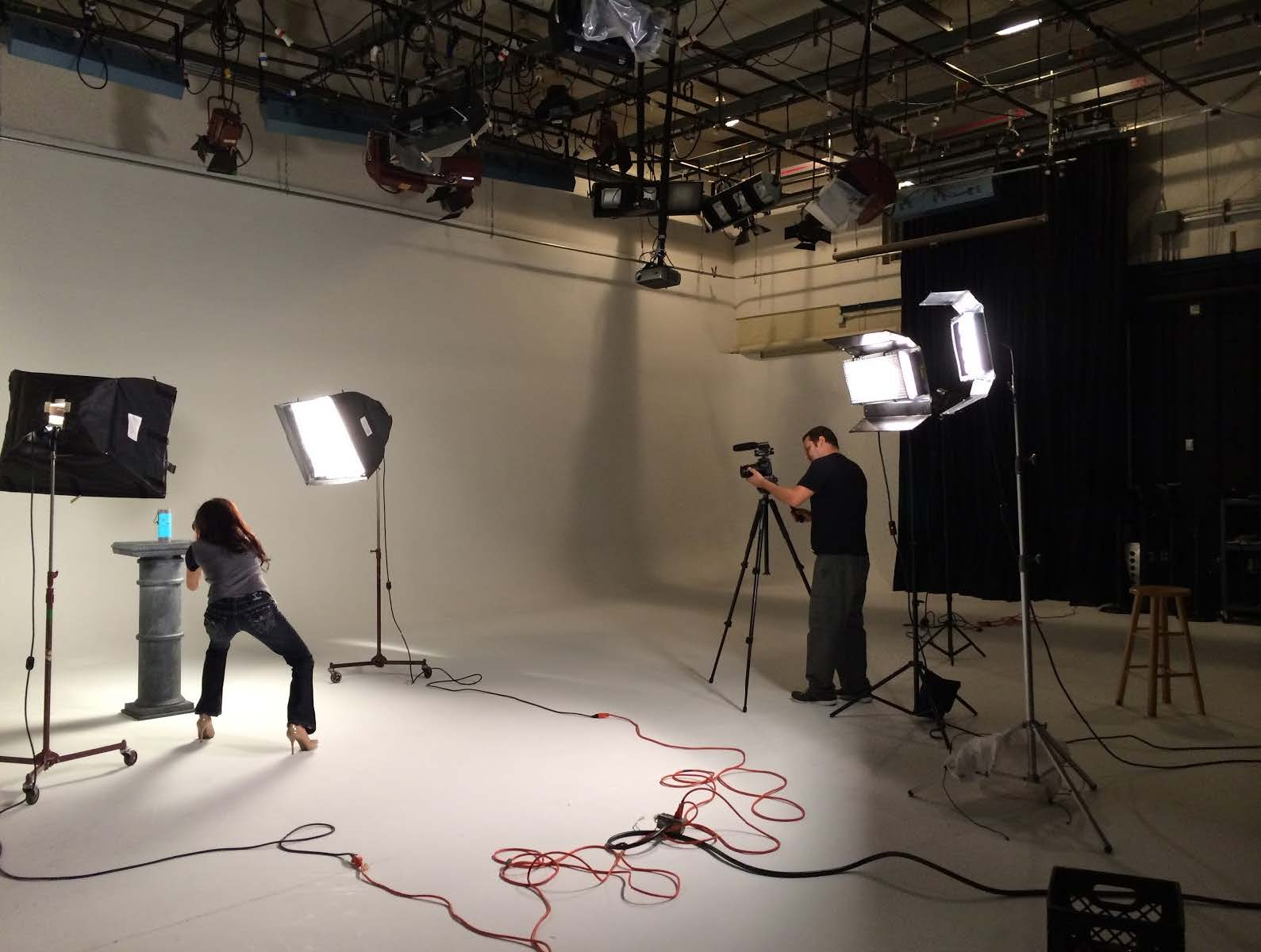 Video crew in a white studio filming product shots of a crowdfunding product