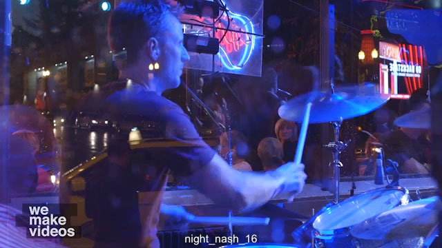 Rock drummer playing in a band outside of a music venue