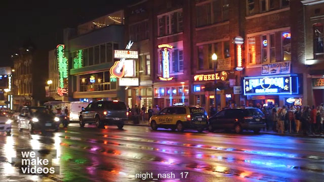 Pan of music venues and bars at night in Nashville