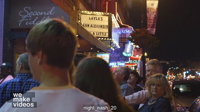 Crowded sidewalk at night in Nashville